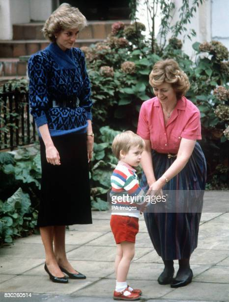 Diana The Princess of Wales looks on as Mrs Jane Mynors greets Prince William at the Victorian terrace house on his first day at Jane Mynors nursery...