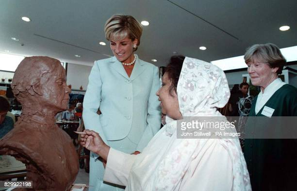 Diana the Princess of Wales with Shamim Lodhi who is showing the Princess her sculpture of Rachael Sullivan supervisor of the sculpture centre which...