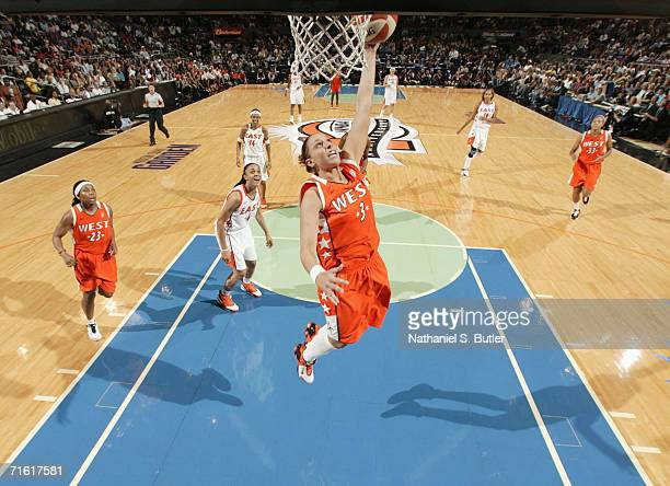 Diana Turasi of the Western Conference AllStars attempts a layup against the Eastern Conference AllStars during the 2006 WNBA AllStar Game at Madison...