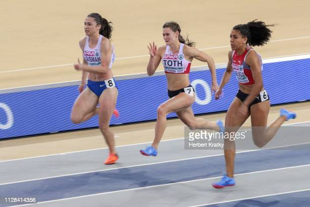 Diana Vaisman of Israel Alexandra Toth of Austria and Mujinga Kambunji of Switzerland compete in the semi finals of the women's 60m event on March 2...