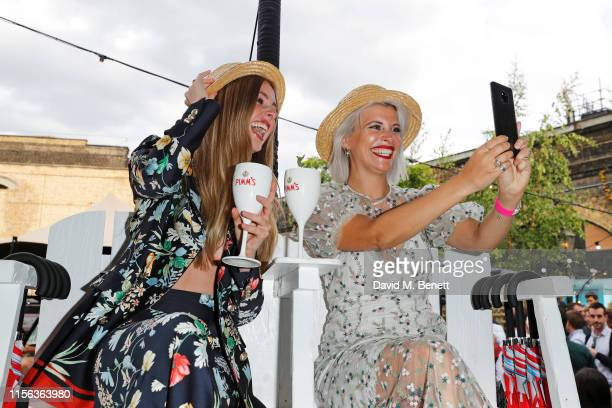 Diana Vickers and Pips Taylor celebrate the Pimm's Summer Garden at Flat Iron Square on July 18 2019 in London England