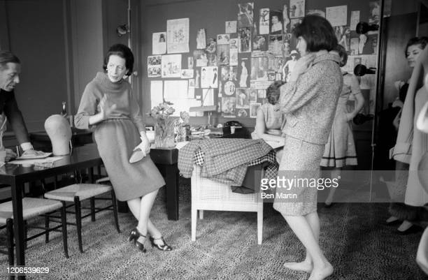 Diana Vreeland Fashion Editor of Harper's Bazaar in her office selecting designs for an issue of the magazine May 1 1953