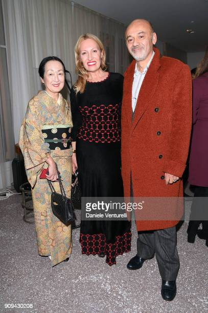 Diana Widmaier Picasso and Christian Louboutin attend Mene 24 Karat Jewelry Presentation at Gagosian Gallery on January 23 2018 in Paris France