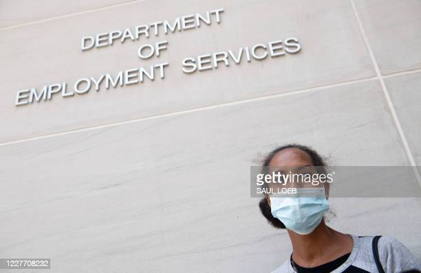 Diana Yitbarek of Washington, DC, stands outside the DC Department of Employment Services, after trying to find out about her unemployment benefits...