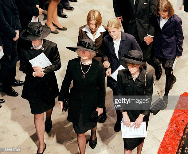 Diana's mother Frances Shand Kidd and Diana's sisters Jane and Sarah and other unidentified members of the Spencer family enter Westminster Abbey...
