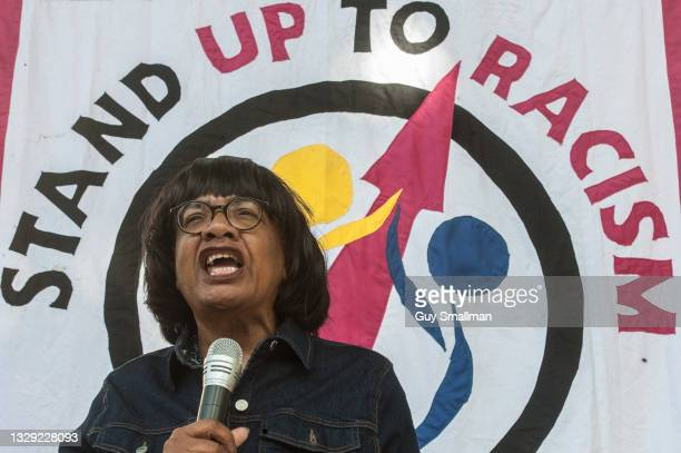 Diane Abbott addresses the protest as supporters of Stand Up To Racism take the knee at Downing street to support black England players racially...