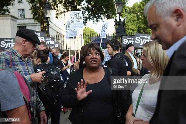 Diane Abbott Labour Party MP for Hackney North and Stoke Newington prepares to address protesters on Whitehall outside Downing Street who are...