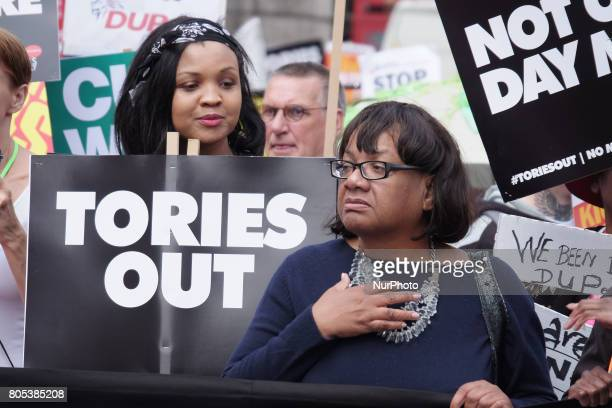 Diane Abbott MP stand at the front of the march in London United Kingdom on July 1 2017 Tens of thousands of people march though central London to...