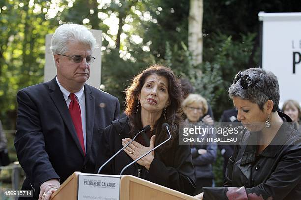 Diane and John Foley the parents of US journalist James Foley deliver a speech translated by Radio France reporter Claude Guibal in the war...
