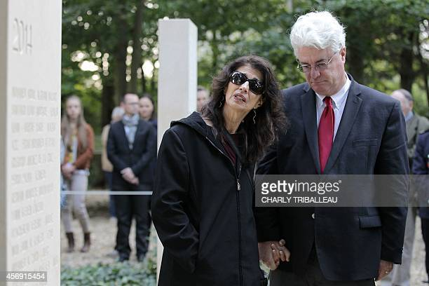 Diane and John Foley the parents of US journalist James Foley stand in the war reporters' memorial after the unveiling of a stone in honor of the war...