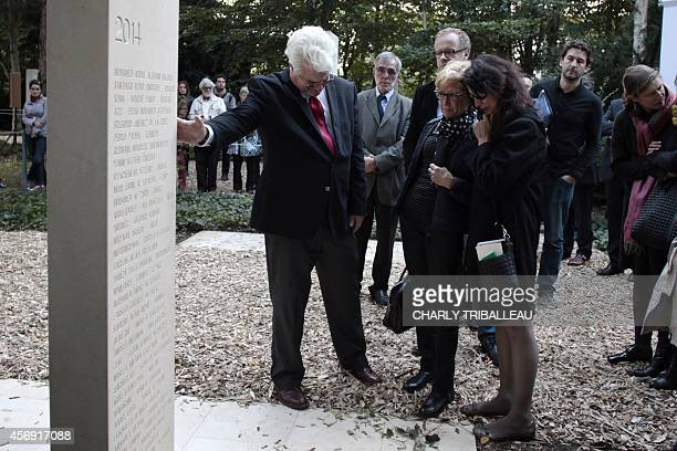 Diane and John Foley the parents of US journalist James Foley stand in the war reporters' memorial with Maryvonne Lepage mother of French...