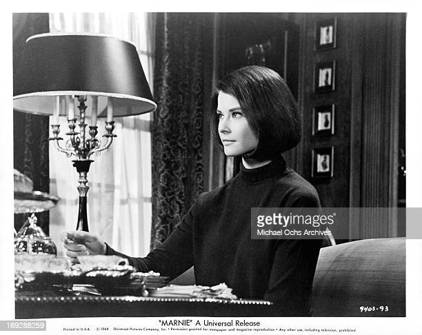 Diane Baker searching through private papers in a scene from the film 'Marnie' 1964
