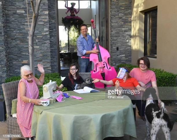 Diane Benjamin Moxie CrimeFighter Jillette holding their dog Betsy Penn Jillette of the comedy/magic team Penn Teller his wife Emily Jillette and...