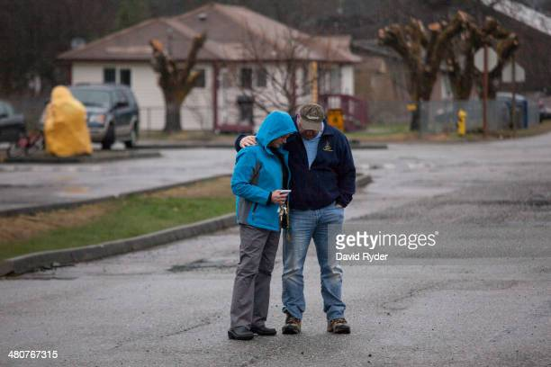 Diane Boyd gets a hug from Julien Loh before a community prayer service on March 26 2014 in Darrington Washington A massive mudslide on March 22 in...