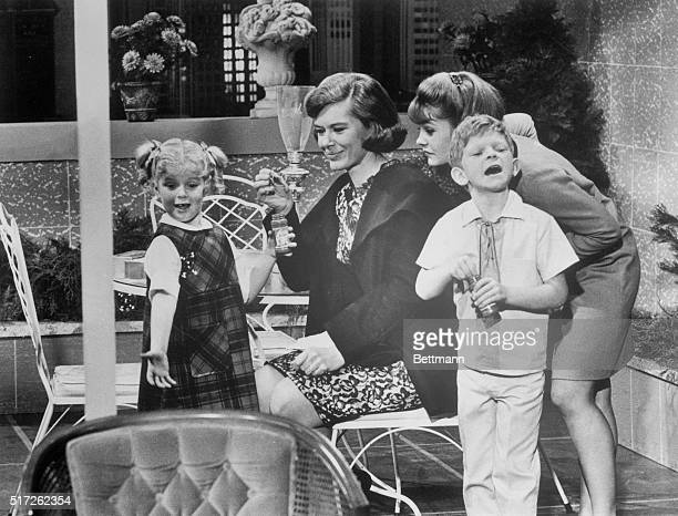 Diane Brewster tries to make friends with Anissa Jones Kathy Garver and Johnnie Whitaker in a scene from the TV series Family Affair 1967