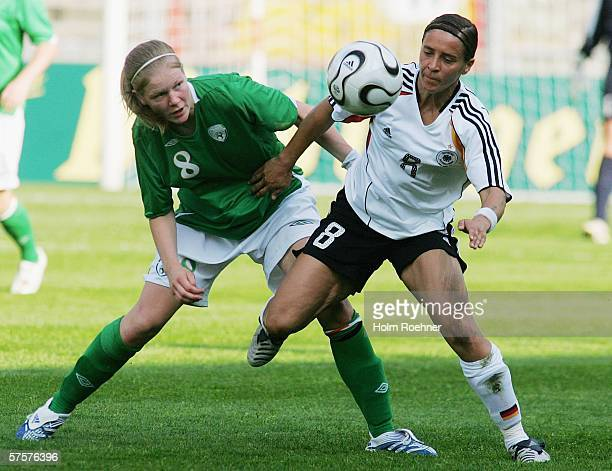 Diane Caldwell of Ireland and Sandra Smisek of Germany chase the ball during the Women's FIFA World Cup China 2007 Qualifying match between Germany...