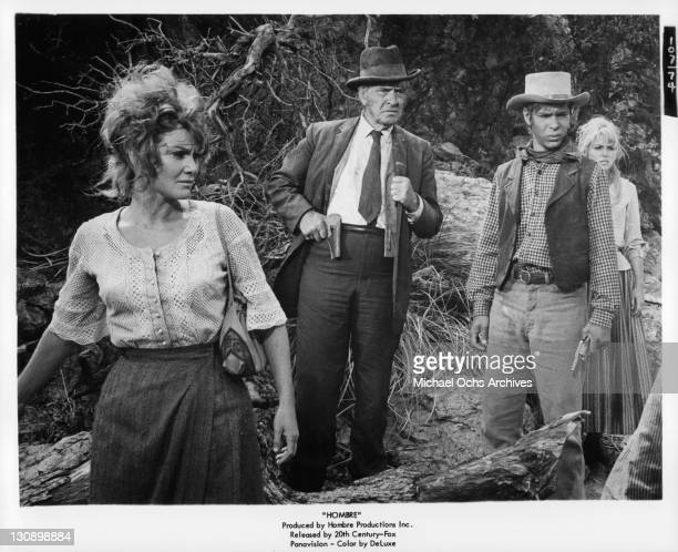 Diane Cilento And Frederic March with others in a scene from the film 'Hombre' 1967