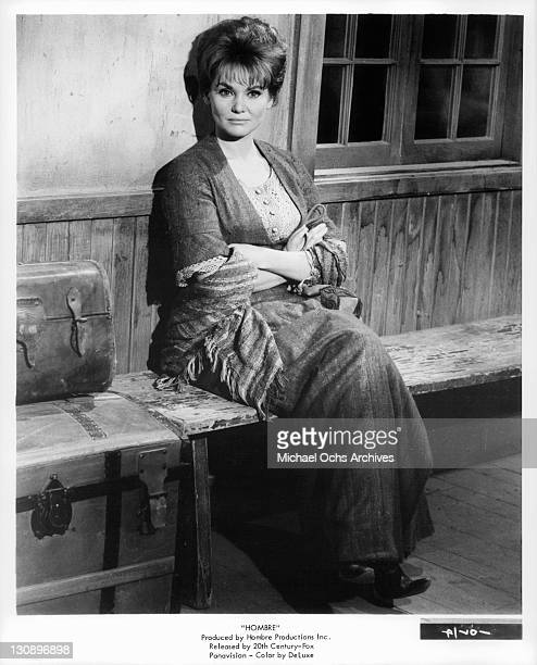 Diane Cilento sit with arms folded in a scene from the film 'Hombre' 1967