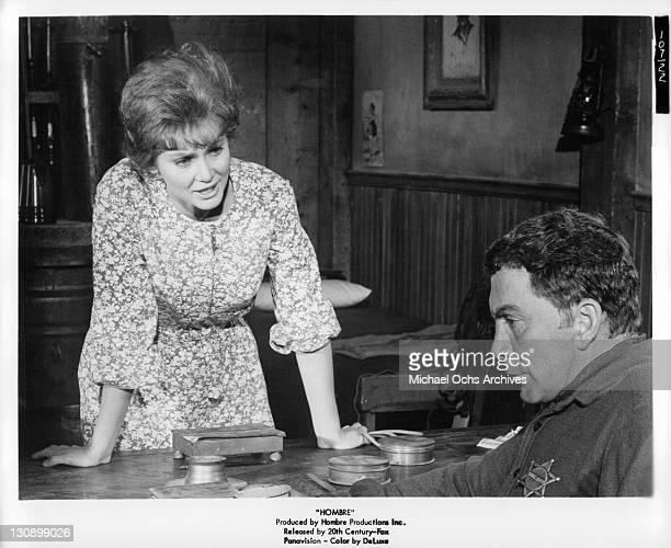 Diane Cilento talking to officer in a scene from the film 'Hombre' 1967