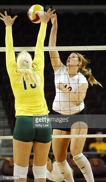 Diane Copenhagen of USC goes up for a spike against Oregon's Mira Djuric during Pacific10 Conference Women's Volleyball match between Oregon and USC...