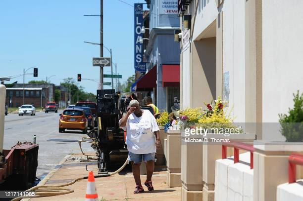 Diane Davis of St Louis stops to leave flowers and pay respects to David Dorn a 77yearold retired police captain who was murdered during overnight...