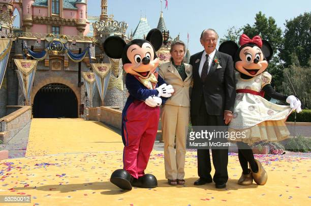 Diane Disney Miller daughter of Walt Disney poses with actor Art Linkletter Mickey and Minnie Mouse at Disneyland's 50th Anniversary rededication...