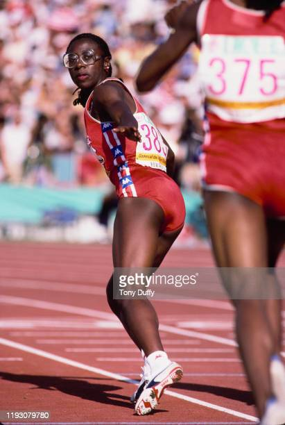 Diane Dixon of the United States hands over to team mate Denean Howard in Heat 1 of the Semi-Final of the Women's 4 × 400 metres relay event on 10th...