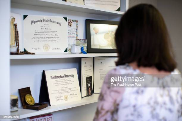 Diane Foley looks at a shelf of trinkets from the life of James Foley at her office at the James W Foley Legacy Foundation in Rochester NH on April...