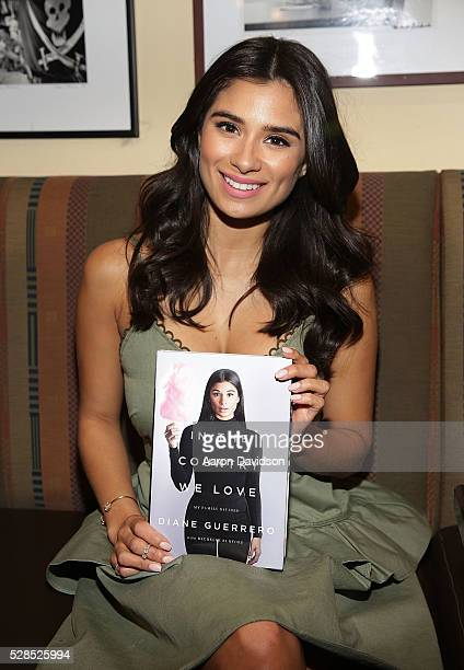 """Diane Guerrero signs copies of her book """"In the Country We Love: My Family Divided """"at Books and Books on May 5, 2016 in Coral Gables, Florida."""