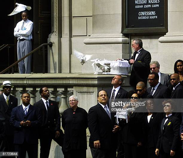 Diane Haughton mother of RB star Aaliyah releases doves in front of the St Ignatius Loyola Church in New York following the funeral services 31...