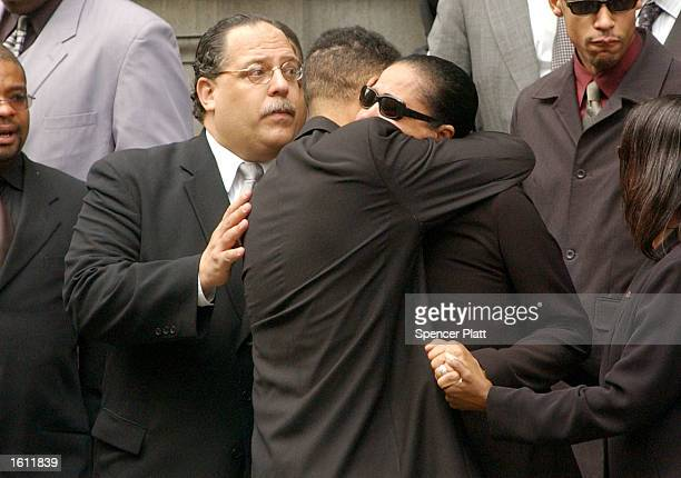 Diane Haughton mother of the late RB star Aaliyah is embraced after funeral services for her daughter August 31 2001 at St Ignatius Loyola Church in...