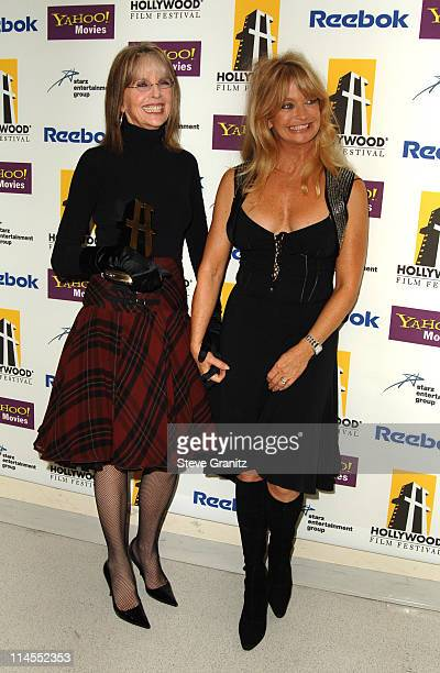 Diane Keaton and Goldie Hawn during 9th Annual Hollywood Film Festival Awards Gala Ceremony Press Room at Beverly Hilton Hotel in Beverly Hills...