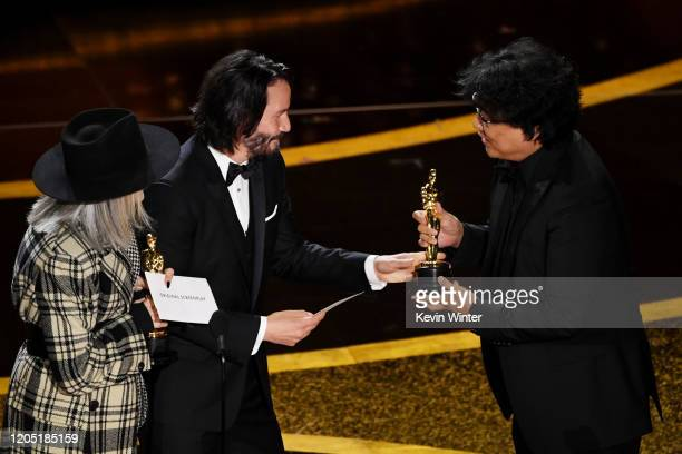 Diane Keaton and Keanu Reeves present the Writing - Original Screenplay - award for 'Parasite' award to Bong Joon-ho onstage during the 92nd Annual...