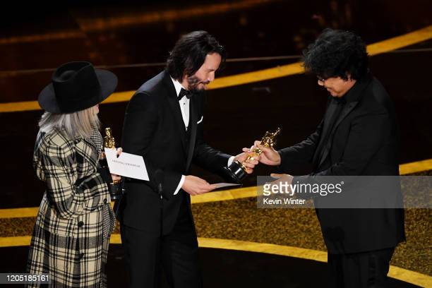 Diane Keaton and Keanu Reeves present the Writing Original Screenplay award for 'Parasite' award to Bong Joonho onstage during the 92nd Annual...
