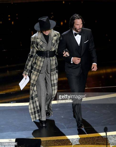 Diane Keaton and Keanu Reeves walk onstage during the 92nd Annual Academy Awards at Dolby Theatre on February 09 2020 in Hollywood California