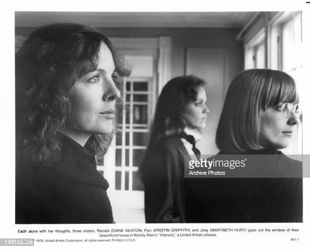 Diane Keaton and Kristin Griffith gaze out the window in a scene from the film 'Interiors' 1978