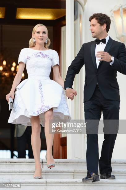 Diane Kruger and Joschua Jackson attend the 2012 amfAR's Cinema Against AIDS during the 65th Annual Cannes Film Festival at Hotel Du Cap on May 24...