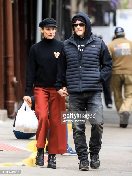 Diane Kruger and Norman Reedus are seen walking in West Village on December 27, 2019 in New York City.