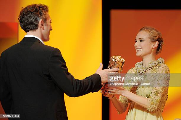 Diane Kruger and Vincent Cassel on stage with his Best Actor Cesar award for Mesrine during the 34th Cesar Awards ceremony held at the Chatelet...