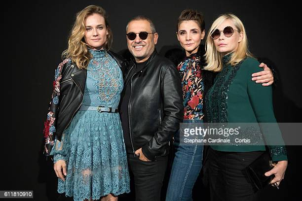 Diane Kruger Fashion designer Elie Saab Clotilde Courau and Emmanuelle Beart pose backstage prior the Elie Saab show as part of the Paris Fashion...