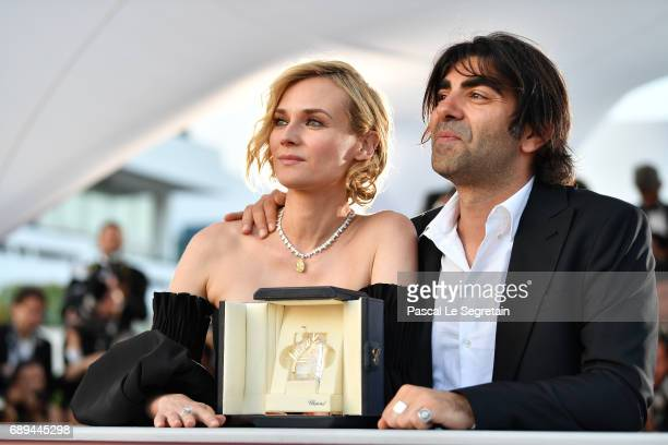 Diane Kruger winner of the award for best actress for her part in the movie In The Fade and director Fatih Akin attend the Palme D'Or winner...