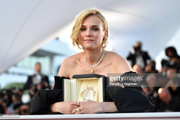 Diane Kruger winner of the award for best actress for her part in the movie In The Fade attends the Palme D'Or winner photocall during the 70th...