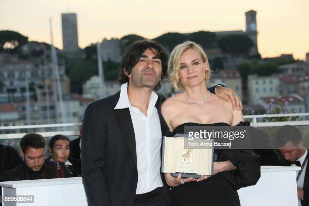 Diane Kruger winner of the award for best actress for her part in the movie 'In The Fade' and director Fatih Akin attend the winners photocall during...