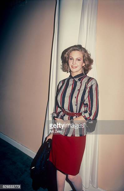 Diane Lane wearing a striped tunic and red skirt; circa 1970; New York.