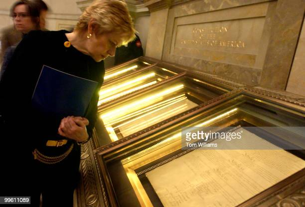 Diane Liesman from the office of Rep Ray LaHood RIll views the Constitution during a tour of the National Archives for House Chiefs of Staff