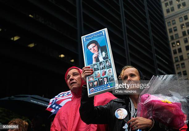 Diane Massaroli of Staten Island New York holds up a picture of her late husband Michael Massaroli who worked at Cantor Fitzgerald at the World Trade...