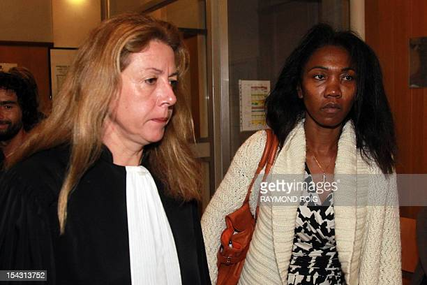 Diane Mistler a Madagascan woman who allegedly tricked one of her many lovers into killing her husband with a fishing harpoon arrives with her lawyer...