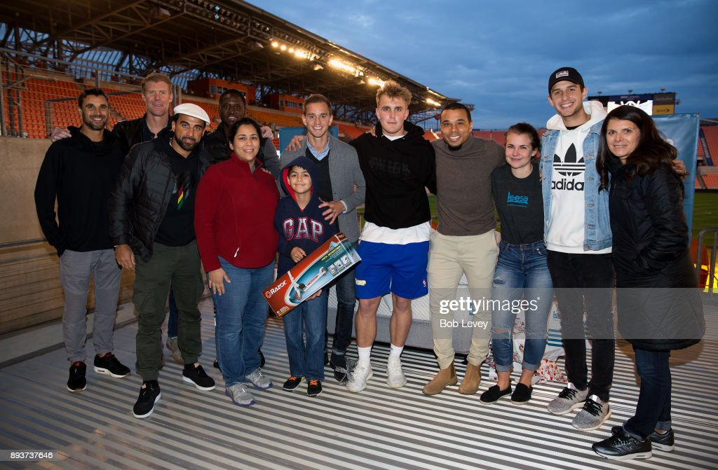 Diane Morales and her son along with Chris Wondolowski, Dwayne De Rosario, Alexi Lalas, Eddie Johnson, Stu Holden, Jake Paul, Charlie Davis, Kade Speiser and Mia Hamm during the Kick in for Houston participants and Leesa Sleep surprise familes affected by Hurricane Harvey with gifts at BBVA Compass Stadium on December 15, 2017 in Houston, Texas.