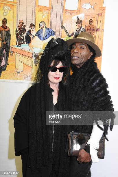 Diane Pernet and Dexter Dex Tao attend Lenedy Angot Calendar 2018 launch at Galerie Fabrice Hybert on December 1 2017 in Paris France