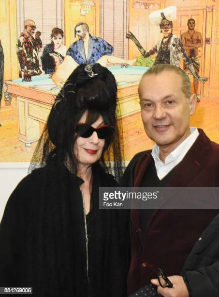 Diane Pernet and Marco de Rivera attend Lenedy Angot Calendar 2018 launch at Galerie Fabrice Hybert on December 1 2017 in Paris France
